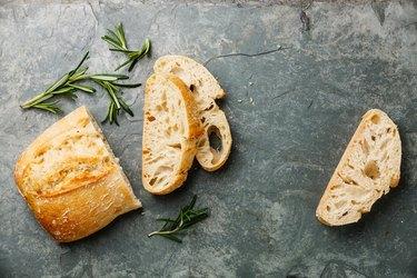 Sliced bread Ciabatta and rosemary