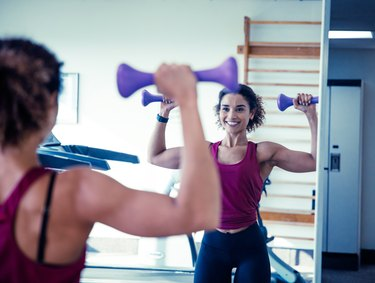 Woman Weight Training With Dumbbells