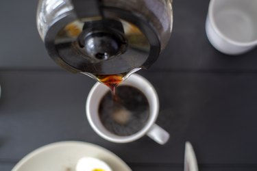 pouring coffee to cup