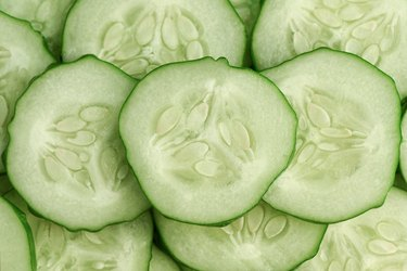 Fresh slice cucumber close-up background.
