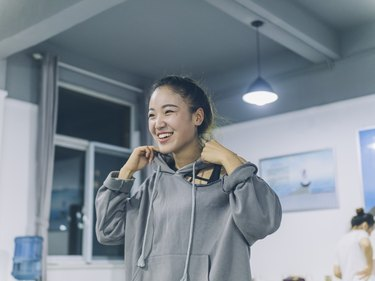 portrait of young female dancing in studio