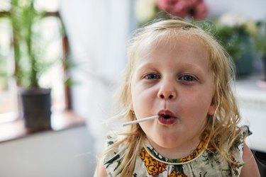 Child eating a lollipop