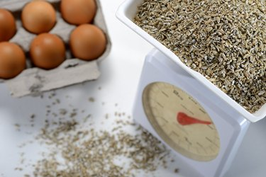 Food scale with crushed rye and eggs