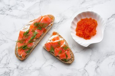 Tasty toast with red salmon and caviar. Top view.