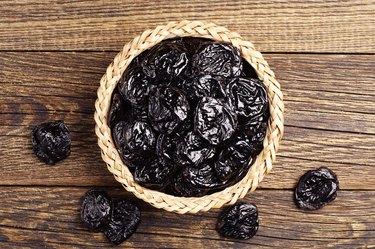 Dried plum in wicker bowl