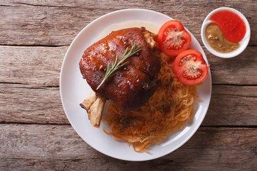 pork shank, sauerkraut and sauce. horizontal top view