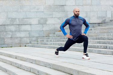 man doing lunges outside for the benefits of lower body strength