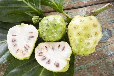 Noni fruits on the table, Morinda citrifolia.
