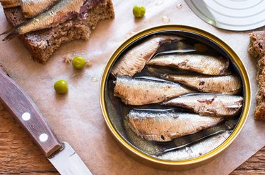 Tin can of sardines on table
