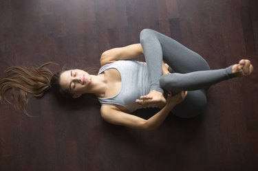 Top view of Eye of the Needle yoga pose