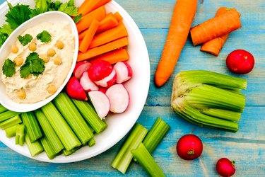 Mediterranean vegetarian hummus dip with fresh vegetables.