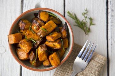 Bowl of oven roasted copper-rich Sweet Potato with rosemary and thyme