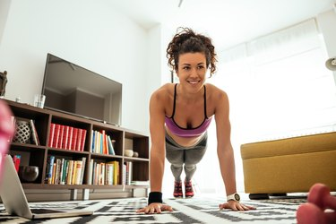 A woman doing a circuit training workout at home