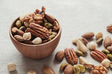 Mixed healthiest nuts in wooden bowl