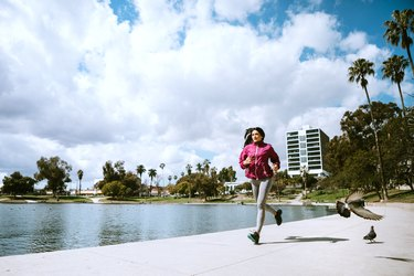 Woman Exercising In Los Angeles City Park