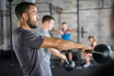 Man doing kettlebell HIIT workout