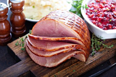 Holiday glazed sliced ham on table with other food