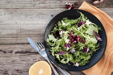 Healthy food. Fresh green salad with spinach,arugula,romaine and lettuce
