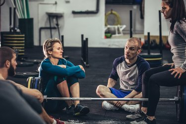 Group of People Resting in a Gym