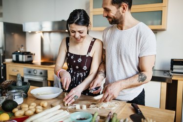Mature couple preparing food for dinner