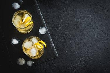 Whiskey on the rocks with lemon peel