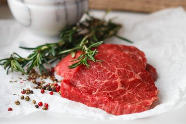Raw beef chops with spices and rosemary