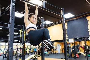 woman works with her own weight on the bar. The concept of building a slim body