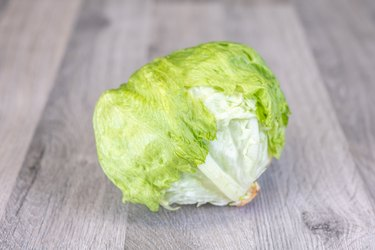 Iceberg lettuce on a wooden table