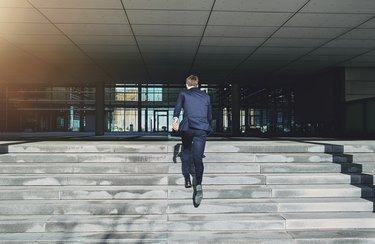 Running up stairs fast man wearing blue suit