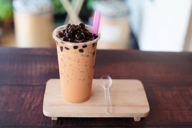 Ice bubble milk tea in takeaway glass