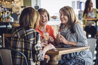 Older women drinking wine at a restaurant