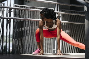 Woman Doing Stretching Fitness Exercise Outdoors