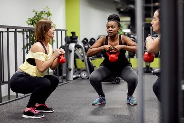 Women Doing a Strength Training Workout In The Gym