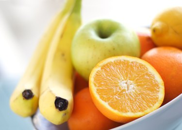 close view of a bowl of fiber-rich fruit, as a natural remedy for hemorrhoids
