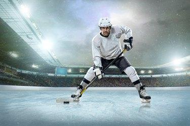 Ice hockey player on the ice. Open stadium