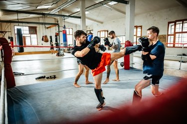 Muay thai boxing athletes training in boxing ring