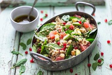 Winter Salad with Quinoa, Avocado, Blood Orange, Pomegranate, Bulgur, Hazelnuts