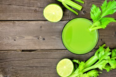 Celery juice, top view over rustic wood with copy space