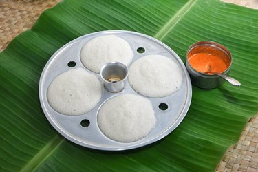 Many Idli or idly in molding plate with coconut chutney