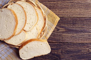 Slices white bread in plate