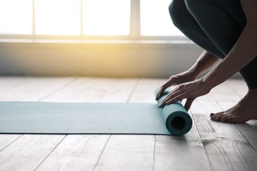 Young Woman Doing Yoga Twist Mat Healthy Lifestyle