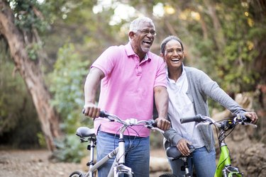 Senior African American Couple Riding Bikes to prevent diabetes with exercise