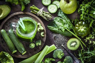 Detox diet concept: green vegetables on rustic table