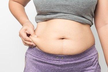 Woman feeling bloated.