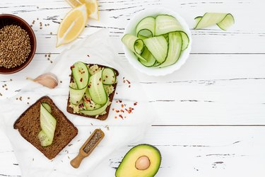 Toast with avocado guacamole and cucumber slices.  Spicy avocado sandwiches