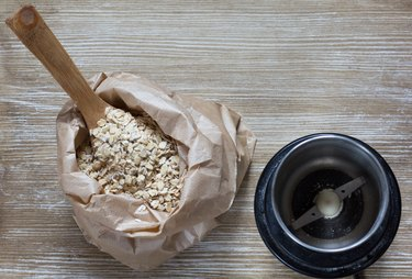Top view of oats and coffee grinder for making oat flour