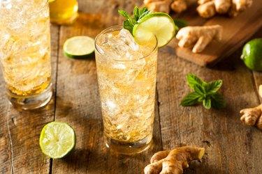 Refreshing golden ginger ale in glass
