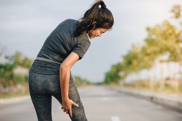 Young woman sport has thigh muscle injury, Health concept