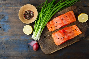 Salmon, onion and spice on cutting board