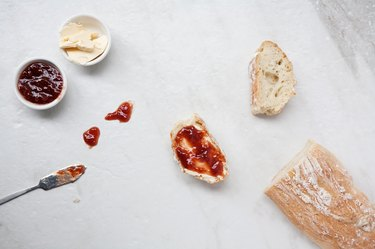Flat lay of homemade french bread baguette sliced